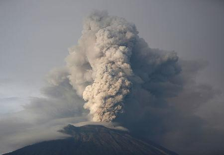 FILE PHOTO: Mount Agung volcano erupts as seen from Kubu, Karangasem Regency, Bali