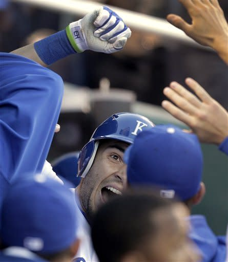 Kansas City Royals' Eric Hosmer celebrates in the dugout after hitting a solo home run during the second inning of a baseball game against the Toronto Blue Jays on Monday, April 23, 2012, in Kansas City, Mo. (AP Photo/Charlie Riedel)
