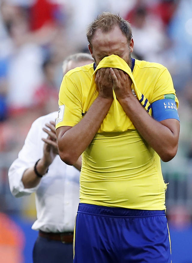 <p>Sweden's Andreas Granqvist cannot hide his misery </p>