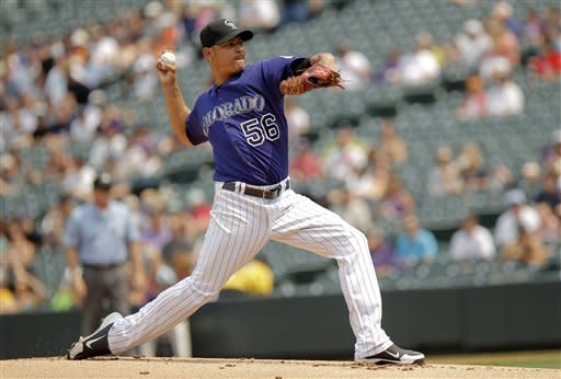 Colorado Rockies starting pitcher Guillermo Moscoso (56) works during the first inning of a baseball game against the Milwaukee Brewers, Wednesday, Aug. 15, 2012, in Denver. (AP Photo/Barry Gutierrez)