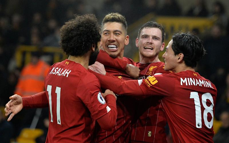 Roberto Firmino celebrates with his teammates after scoring the winner for Liverpool - REX