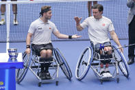 Gordon Reid, right, and Alfie Hewett, both of Britain, celebrate winning the men's wheelchair doubles final at the U.S. Open tennis tournament in New York, Saturday, Sept. 11, 2021. (AP Photo/Seth Wenig)