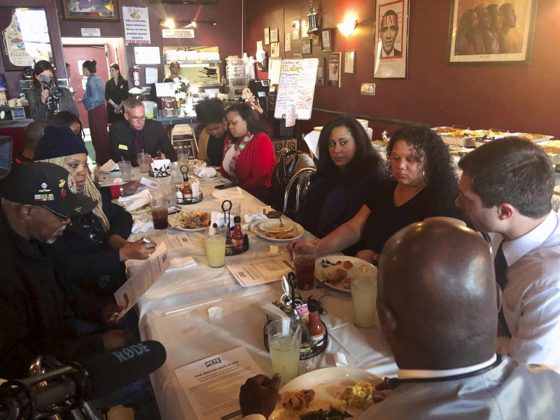 Democratic presidential candidate Pete Buttigieg meets with black voters at a soul food restaurant in North Las Vegas, Nev., Saturday, Dec. 21, 2019. (AP Photo/Michelle L. Price)