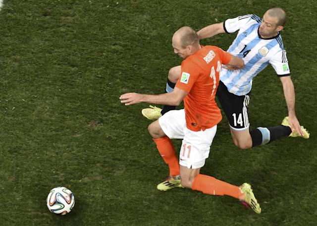 Netherlands' Arjen Robben (11) is challenged by Argentina's Javier Mascherano (14) during the World Cup semifinal soccer match between the Netherlands and Argentina at the Itaquerao Stadium in Sao Paulo, Brazil, Wednesday, July 9, 2014. (AP Photo/Francois Xavier Marit, Pool)