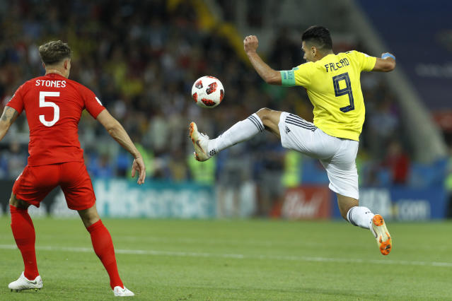 <p>Colombia's Radamel Falcao, right, lunges for the ball against England's John Stones during the round of 16 match between Colombia and England at the 2018 soccer World Cup in the Spartak Stadium, in Moscow, Russia, Tuesday, July 3, 2018. (AP Photo/Victor R. Caivano) </p>