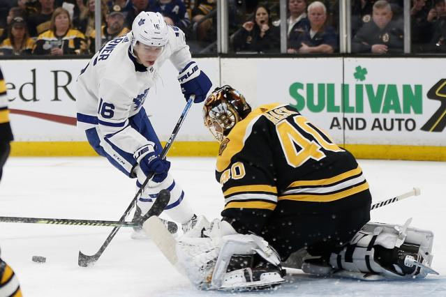 Boston Bruins' Tuukka Rask (40) blocks a shot by Toronto Maple Leafs' Mitchell Marner (16) during the first period in Game 5 of an NHL hockey first-round playoff series in Boston, Friday, April 19, 2019. (AP Photo/Michael Dwyer)