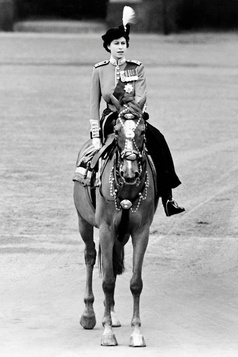 The Queen riding side-saddle in 1962 at Trooping the Colour (Getty Images)