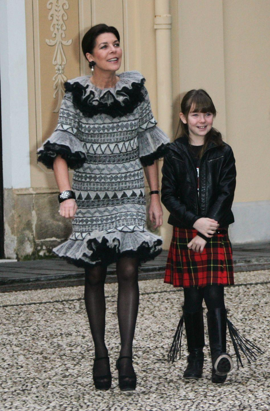 """<p>Princess Caroline and her youngest daughter, <a href=""""https://www.townandcountrymag.com/society/tradition/g31251104/princess-alexandra-of-hanover-photos-style/"""" rel=""""nofollow noopener"""" target=""""_blank"""" data-ylk=""""slk:Princess Alexandra of Hanover"""" class=""""link rapid-noclick-resp"""">Princess Alexandra of Hanover</a>, at a Christmas event at the Royal Palace in 2009.</p>"""