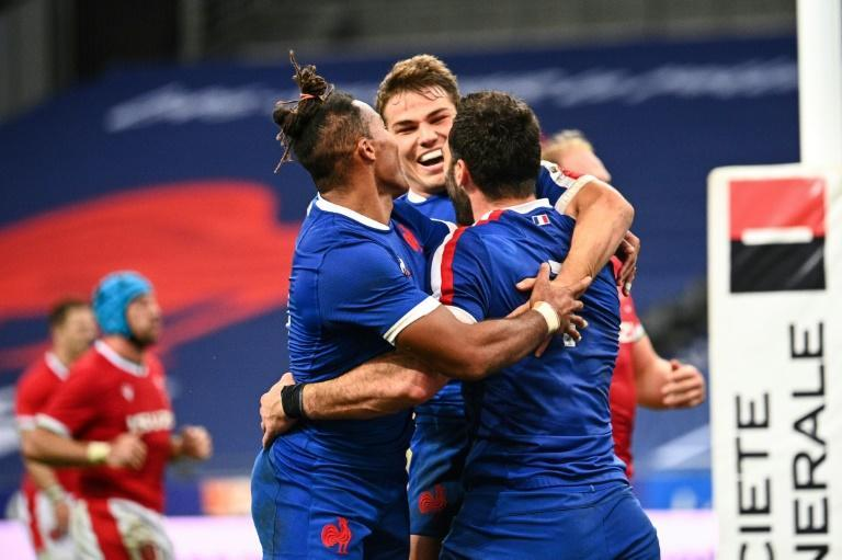 Celebration: France flanker Charles Ollivon celebrates with wing Teddy Thomas and Antoine Dupont
