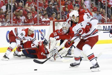 Apr 20, 2019; Washington, DC, USA; Washington Capitals goaltender Braden Holtby (70) prepares to make a save Carolina Hurricanes right wing Justin Williams (14) in the second period in game five of the first round of the 2019 Stanley Cup Playoffs at Capital One Arena. Mandatory Credit: Geoff Burke-USA TODAY Sports