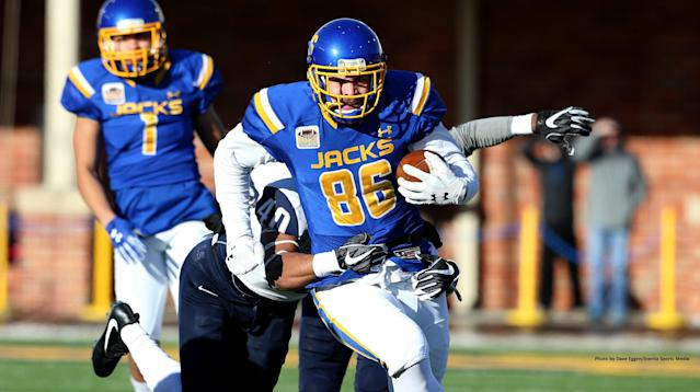 BROOKINGS, SD - DECEMBER 9: Dallas Goedert #86 from South Dakota State University tries to slip the grasp of Pop Lacey #40 from the University of New Hampshire during their FCS quarterfinal game Saturday afternoon at Dana J. Dykhouse Stadium in Brookings, SD. (Photo by Dave Eggen/Inertia)