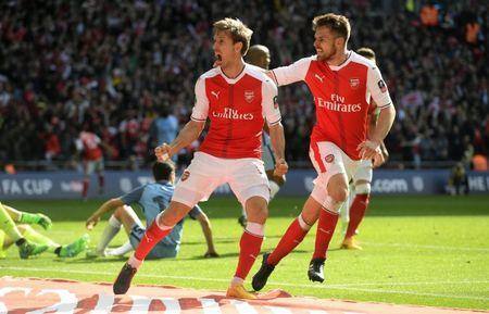 Britain Football Soccer - Arsenal v Manchester City - FA Cup Semi Final - Wembley Stadium - 23/4/17 Arsenal's Nacho Monreal celebrates scoring their first goal with Aaron Ramsey Reuters / Toby Melville Livepic