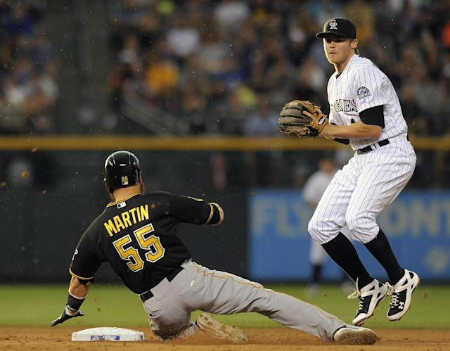 Pittsburgh Pirates Russell Martin (55) slides safely into second base past Colorado Rockies second baseman DJ LeMahieu to avert a triple play in the fifth inning of a baseball game on Friday, July 25, 2014, in Denver. (AP Photo/Chris Schneider)