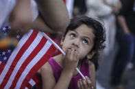 <p>First generation Yemeni-American Ghadeer Almontaser, 5, of Brooklyn, holds an American flag as protesters hold a rally outside of Manhattan Federal Court on June 26, 2018 in New York City. (Photo: Byron Smith/Getty Images) </p>