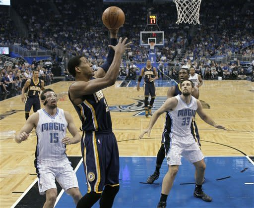 Indiana Pacers' Danny Granger, center, gets past Orlando Magic's Hedo Turkoglu (15) and Ryan Anderson (33) for a shot during the first half of Game 4 of an NBA first-round playoff basketball series, Saturday, May 5, 2012, in Orlando, Fla. (AP Photo/John Raoux)