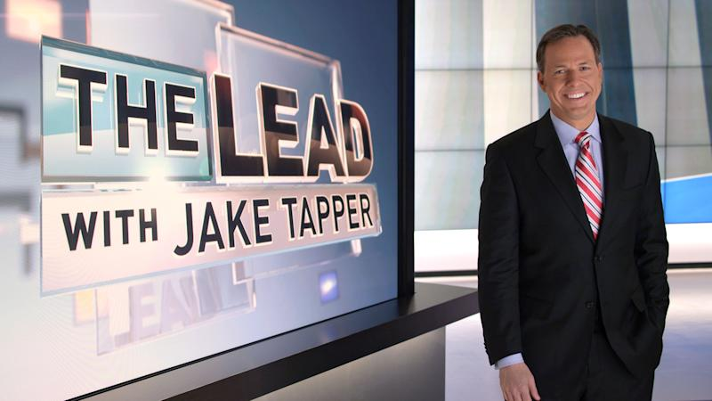 """This undated image from video provided by CNN shows Jake Tapper on the set of his show """"The Lead with Jake Tapper."""" Tapper says he wants the show to be a broad look at the news, encompassing business, politics and entertainment. (AP Photo/CNN)"""