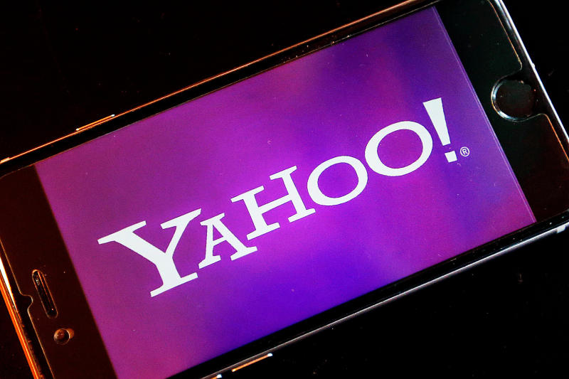 FILE - In this Dec. 15, 2016, file photo, the Yahoo logo appears on a smartphone in Frankfurt. Yahoo Japan Corp. said Thursday, Sept. 12, 2019 it will put up a tender offer, estimated at 400 billion yen ($3.7 billion), for Zozo Inc., a Japanese online retailer started by a celebrity tycoon. Yahoo Japan announced the plan which includes a business alliance with Zozo. (AP Photo/Michael Probst, File)