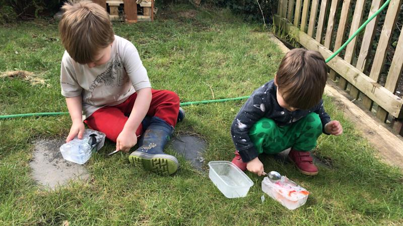 Two U.K. boys had to rescue their toys from ice thanks to their dad's clever parenting hack. (Photo: SWNS)