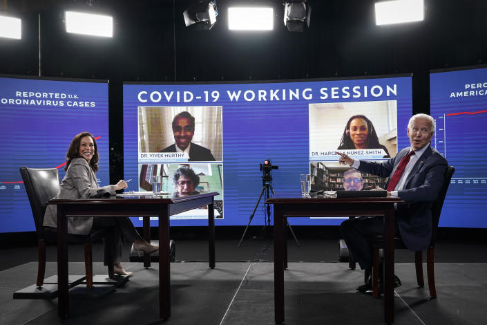 WILMINGTON, DE - AUGUST 13: Democratic presidential candidate former Vice President Joe Biden (R) and his running mate Sen. Kamala Harris (D-CA) acknowledge the press as they attend a coronavirus briefing at a makeshift studio at the Hotel DuPont on August 13, 2020 in Wilmington, Delaware. Harris is the first woman of color in U.S. history to be named to the top of a major party presidential ticket. (Photo by Drew Angerer/Getty Images)