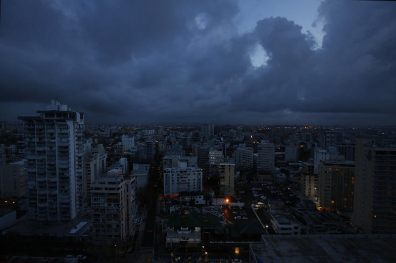 In downtown San Juan, any building with lights on is running a generator. There is no electric utility running on the island. (Carolyn Cole/Los Angeles Times via Getty Images)