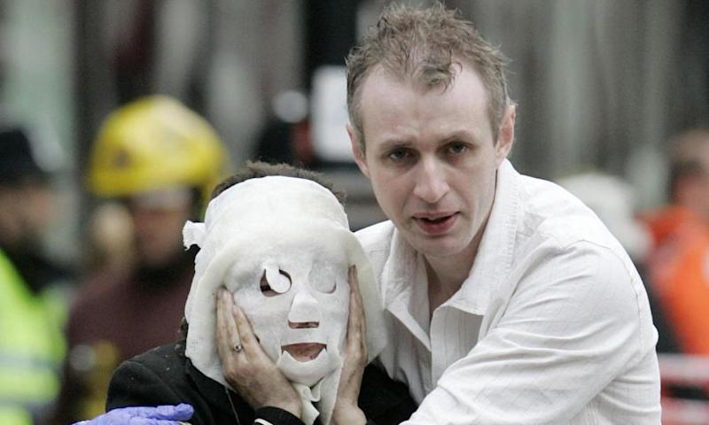 Paul Dadge comforting an injured woman after the 7/7 attacks in 2005