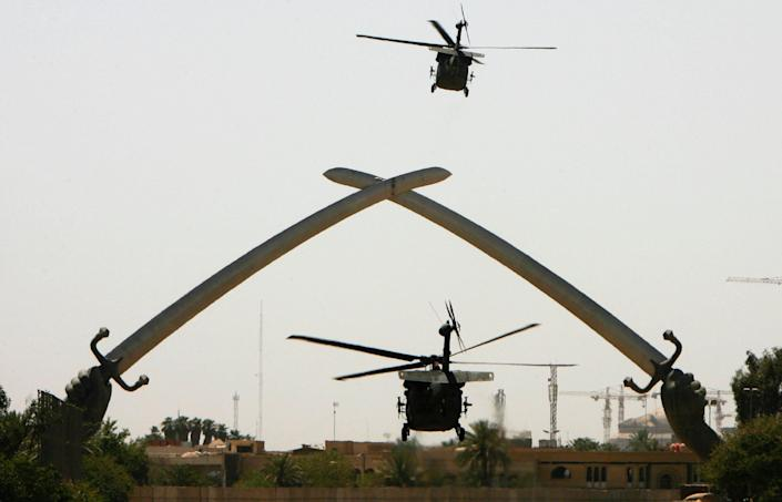 Black Hawk helicopters take off from Baghdad's Green Zone