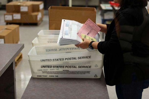 PHOTO: Eliza Luna, a ballot designer with the Maricopa County Elections Department, counts ballots for the Arizona Presidential Preference Election at the Maricopa County Tabulation and Election Center in Phoenix, March 17, 2020. (Cheney Orr/Reuters)