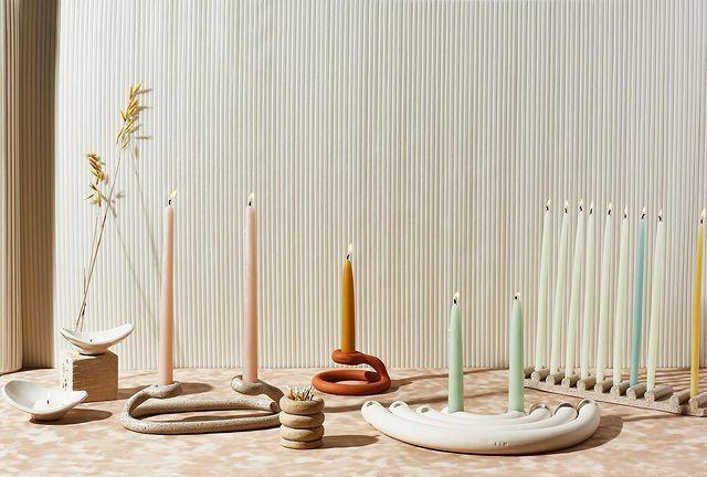 """<p>Designer Virginia Sin crafts simple and beautiful ceramics (including the curvey, coiled candlesticks seen here) out of her Brooklyn studio. The chic designs shoppable on <a href=""""https://virginiasin.com/"""" rel=""""nofollow noopener"""" target=""""_blank"""" data-ylk=""""slk:her site"""" class=""""link rapid-noclick-resp"""">her site</a> — and now available at <a href=""""https://www.westelm.com/shop/collaborations/virginia-sin/"""" rel=""""nofollow noopener"""" target=""""_blank"""" data-ylk=""""slk:West Elm"""" class=""""link rapid-noclick-resp"""">West Elm</a> — are still refreshingly affordable considering her pieces have been acquired by museums and a set of plates she designed is used in one of the most exclusive restaurants in the world, <a href=""""https://www.theworlds50best.com/awards/best-of-the-best/eleven-madison-park.html"""" rel=""""nofollow noopener"""" target=""""_blank"""" data-ylk=""""slk:Eleven Madison Park."""" class=""""link rapid-noclick-resp"""">Eleven Madison Park.</a></p> <p><strong>Buy It! </strong>Uni Candlestick (center); $38; <a href=""""https://virginiasin.com/"""" rel=""""nofollow noopener"""" target=""""_blank"""" data-ylk=""""slk:virginiasin.com"""" class=""""link rapid-noclick-resp"""">virginiasin.com</a></p>"""