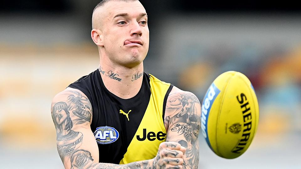 Richmond star Dustin Martin got away with a fine after punching Port Adelaide's Tom Rockliffe in the throat. (Photo by Bradley Kanaris/Getty Images)