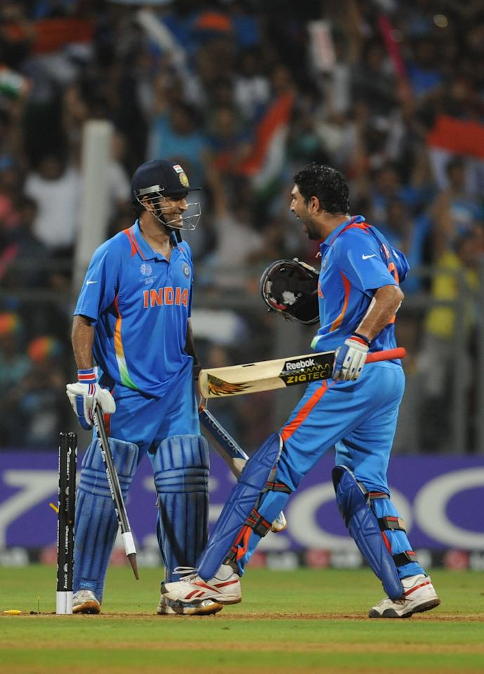 Indian batsman Yuvraj Singh (R) and Mahendra Singh Dhoni celebrate their victory during the ICC Cricket World Cup final match between India and Sri Lanka at The Wankhede Stadium in Mumbai on April 2, 2011. India defeated Sri Lanka by six wickets to win the 2011 World Cup. AFP PHOTO / Prakash SINGH (Photo credit should read PRAKASH SINGH/AFP/Getty Images)