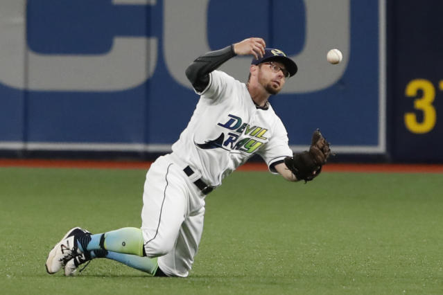 FILE - In this Aug. 30, 2019, file photo, Tampa Bay Rays second baseman Eric Sogard makes a catch during the first inning of the team's baseball game against the Cleveland Indians in St. Petersburg, Fla. Sogard is getting a second chance with the Milwaukee Brewers. Milwaukee finalized his $4.5 million, one-year contract Friday, Dec. 20, along with a $5 million, one-year deal for first baseman Justin Smoak. (AP Photo/Scott Audette, File)