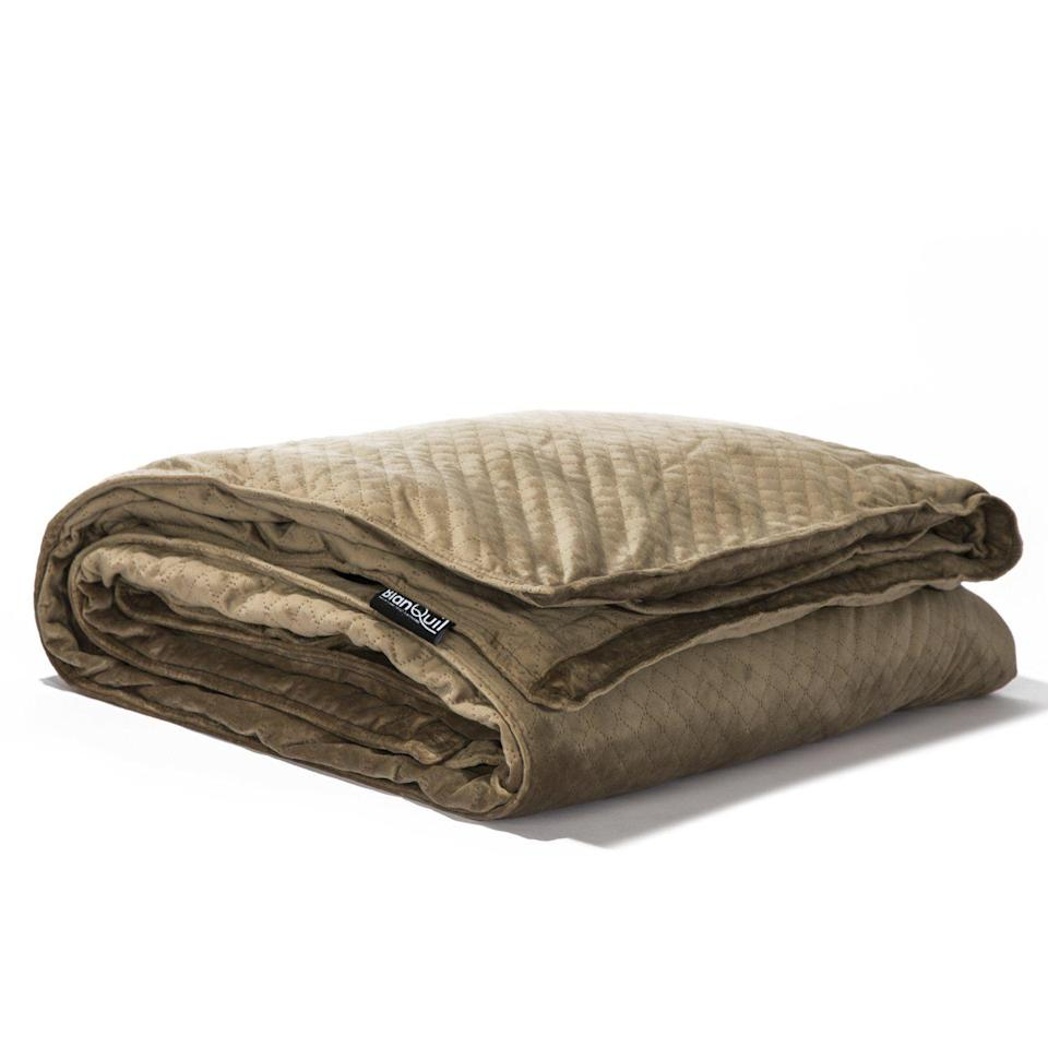 """<p><strong>BlanQuil </strong></p><p>myblanquil.com</p><p><strong>$169.00</strong></p><p><a href=""""https://myblanquil.com/products/blanquil-quilted-weighted-blanket"""" rel=""""nofollow noopener"""" target=""""_blank"""" data-ylk=""""slk:Shop Now"""" class=""""link rapid-noclick-resp"""">Shop Now</a></p><p>This weighted blanket will certainly apply enough pressure to help you get some much-needed shut-eye after a long day. </p>"""