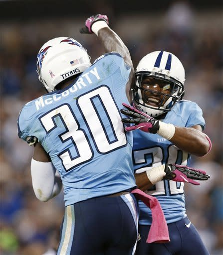 Tennessee Titans cornerback Jason McCourty (30) celebrates with defensive back Al Afalava (38) after intercepting a pass from Pittsburgh Steelers quarterback Ben Roethlisberger during the first half of an NFL football game Thursday, Oct. 11, 2012, in Nashville, Tenn. (AP Photo/Joe Howell)