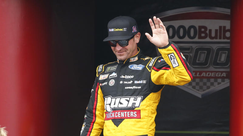 Monster Energy NASCAR Cup Series driver Clint Bowyer (14) waves at driver introductions during a NASCAR Cup Series auto race at Talladega Superspeedway, Sunday, Oct. 14, 2019, in Talladega, Ala. (AP Photo/Butch Dill)