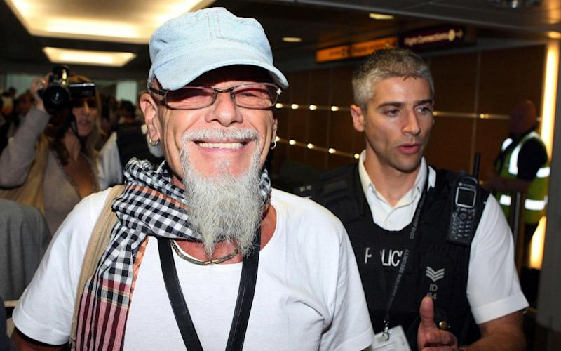 Paedophile pop star Gary Glitter arrives at Heathrow Airport - PA