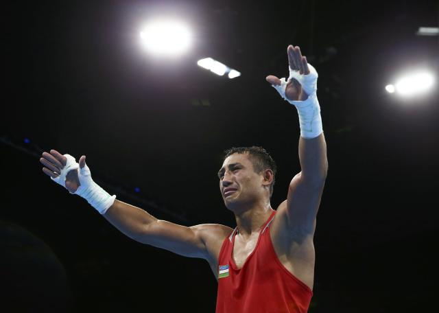 2016 Rio Olympics - Boxing - Final - Men's Light Welter (64kg) Final Bout 272 - Riocentro - Pavilion 6 - Rio de Janeiro, Brazil - 21/08/2016. Fazliddin Gaibnazarov (UZB) of Uzbekistan reacts. REUTERS/Peter Cziborra FOR EDITORIAL USE ONLY. NOT FOR SALE FOR MARKETING OR ADVERTISING CAMPAIGNS.