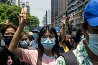 Yangon protesters returned to the streets, flashing three-finger salutes