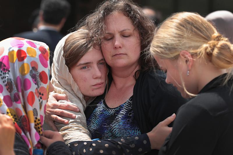Sabika Sheikh's host family members are comforted following a funeral prayer service at the Brand Lane Islamic Center on May 20, 2018 in Stafford, Texas. (Scott Olson via Getty Images)