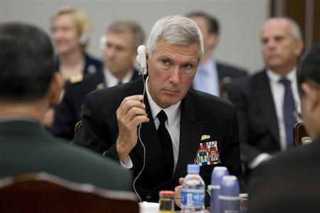 Admiral Locklear, commander of the U.S. Pacific Command, adjusts his translation earpiece at the start of the 45th Security Consultative Meeting at the Defence Ministry in Seoul