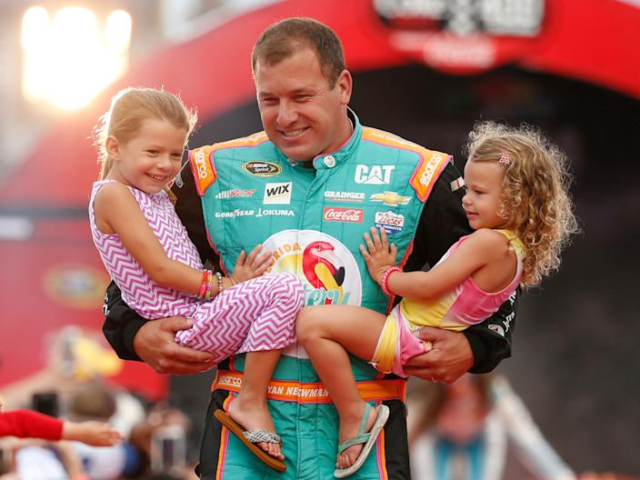 Ryan Newman holds his daughters Brooklyn, left, and Ashlyn during driver introductions before the start of the NASCAR Sprint Cup auto race at Daytona International Speedway, Saturday, July 2, 2016, in Daytona Beach, Florida.