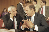 FILE - In this July 31, 1986, file photo Sen. Paul Laxalt, R-Nev., left, and Sen. Joseph Biden, Jr., D-Del., meet prior to a Senate Judiciary Committee confirmation hearing at Capitol Hill in Washington. The panel was meeting to install William Rehnquist as chief justice of the United States. (AP Photo/Lana Harris, File)