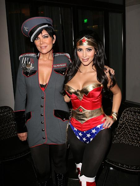Kris Jenner and Kim Kardashian, dressed as Superwoman, at Kim's Halloween party, hosted by PAMA in Los Angeles on October 30, 2008.
