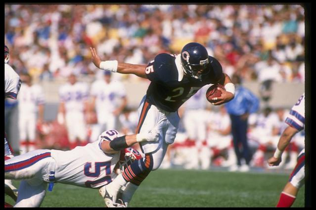 2 Oct 1988: Running back Brad Muster of the Chicago Bears (right) gets tackled by a Buffalo Bills player during a game at Soldier Field in Chicago, Illinois. The Bears won the game, 24-3.