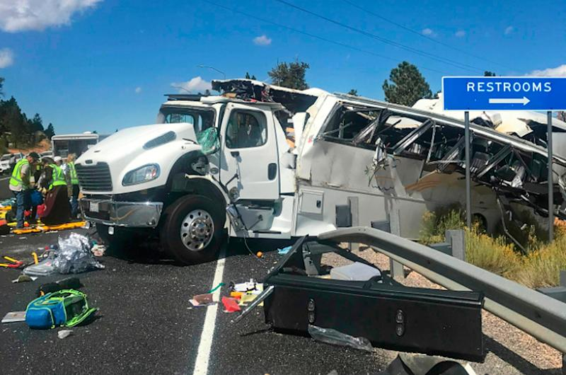 The bus was pictured hanging over guardrails on Utah's busy State Route 12 (AP)