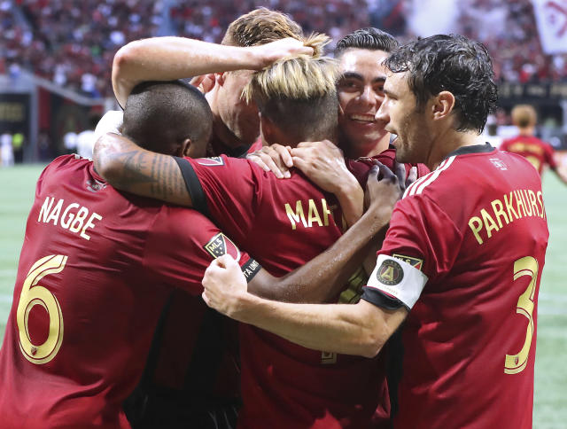 Atlanta United players celebrate with Josef Martinez after his first of three goals in the team's 3-1 victory against the Philadelphia Union in an aMLS soccer match Saturday, June 2, 2018, in Atlanta. (Curtis Compton/Atlanta Journal-Constitution via AP)