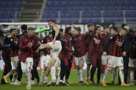 AC Milan players celebrate their win against Lazio after the end of a Serie A soccer match between AC Milan and Lazio, at the San Siro stadium in Milan, Italy, Wednesday, Dec. 23, 2020. (AP Photo/Luca Bruno)