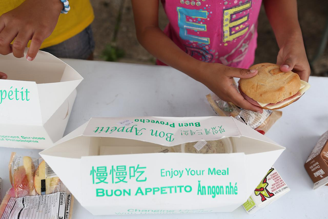 An unpaid neighborhood do-gooder in partnership with some powerful allies - the U.S. government and the Roman Catholic Church - distributes free lunches and snacks in Franklinville.     <br />