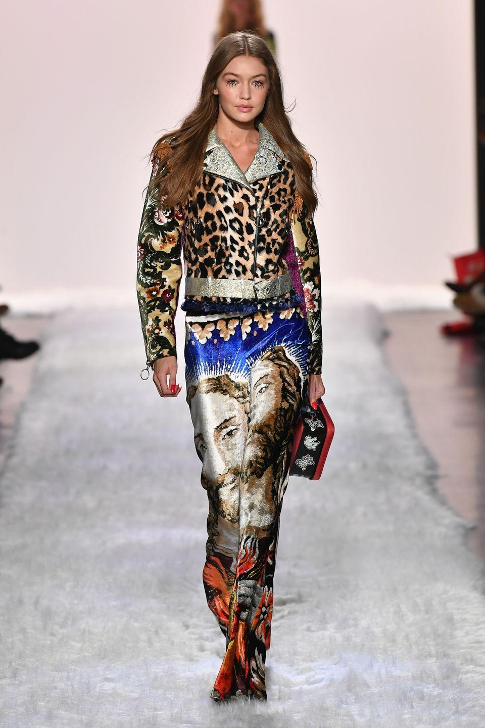 <p>Gigi wore a leopard-print jacket on the runway at the Jeremy Scott fashion show in New York City.<br></p>