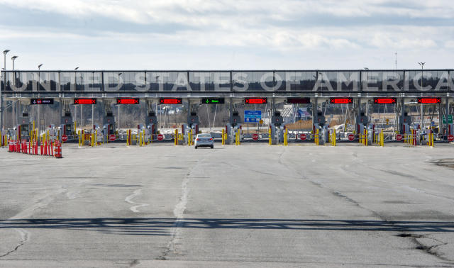 """A vehicle approaches the only open lane at the United States border crossing in Lacolle, Quebec, Wednesday, March 18, 2020. The Canada-U.S. border will be closed to non-essential traffic in both directions """"by mutual consent,"""" U.S. President Donald Trump confirmed Wednesday, as efforts across the continent to contain the widening COVID-19 pandemic continued to upend daily life in North America. (Ryan Remiorz/The Canadian Press via AP)"""