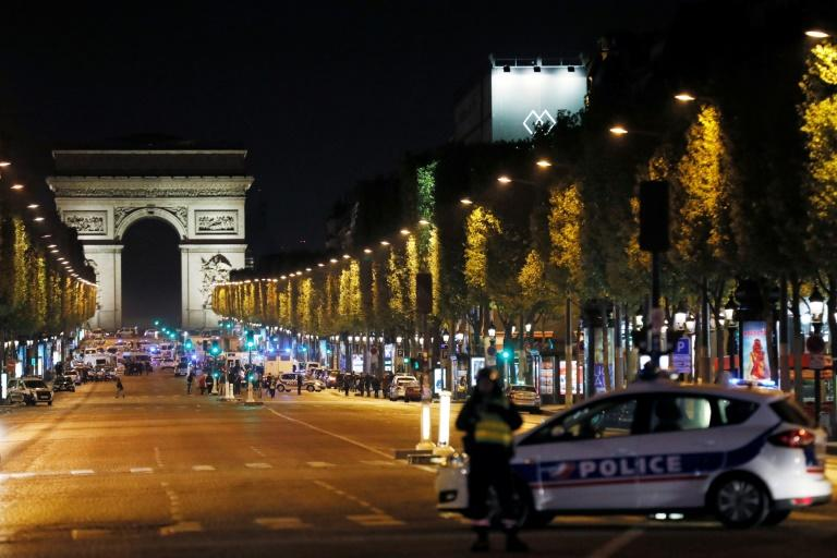 Police block access to the Champs Elysees in Paris after a shooting left one officer dead and two wounded